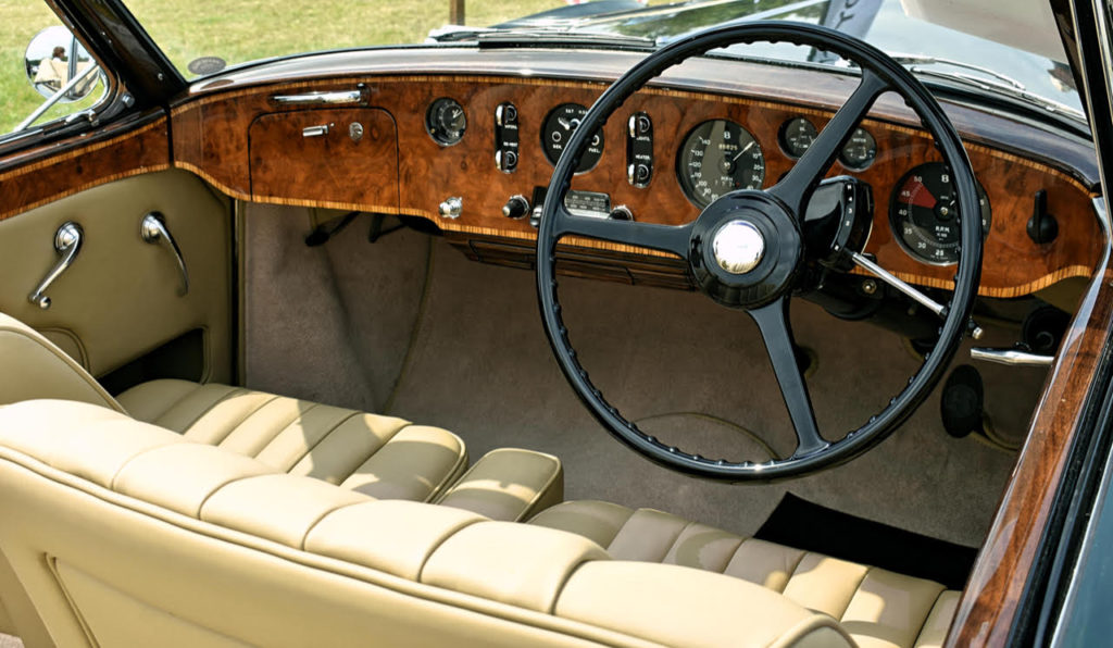 A typical postwar dashboard featuring clear instrumentation and luxurious inlaid wood veneers (photo: Richard Fenner)