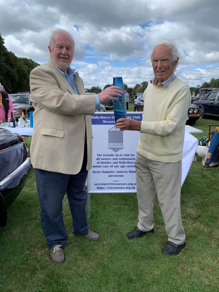 New Chairman Brian Palmer (left) receives his blue vase award from the 2019 AGM from past Chairman Stuart Bladon at the South of England Rally